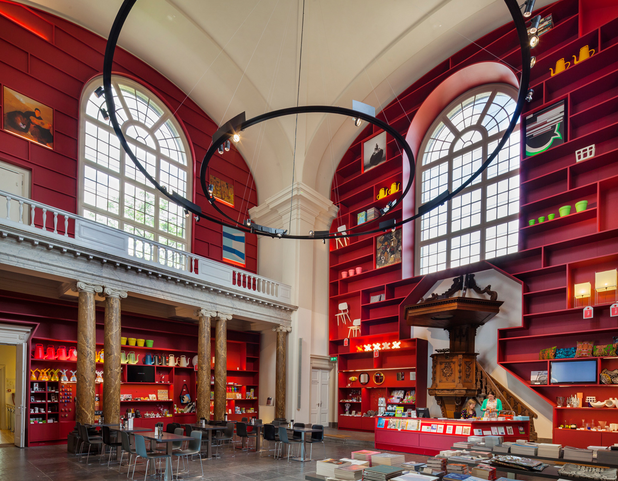 Transformation Stedelijk Museum Schiedam: MVRDV wraps interior of historical chapel in red shelves